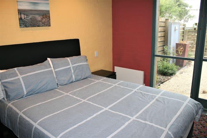 Master bedroom downstairs with Queen bed: overlooks secured garden courtyard.