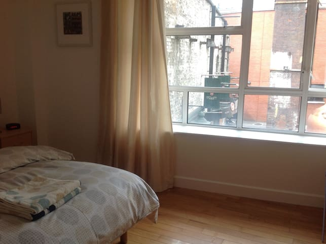 Bedroom 1 with window over lively courtyard. All quiet at night for a great nights sleep