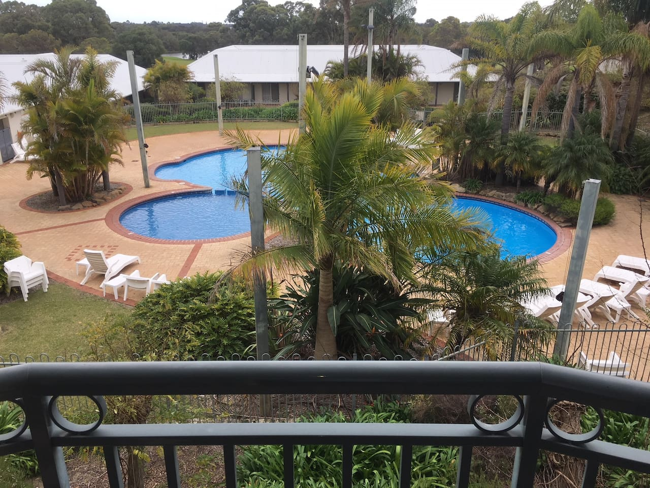View over pool from upstairs balcony
