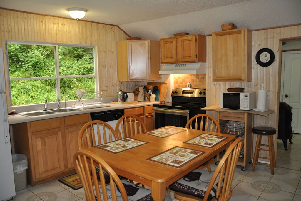 Kitchen with all amenities. Dining for 6.  Romantic dinner or family game night!