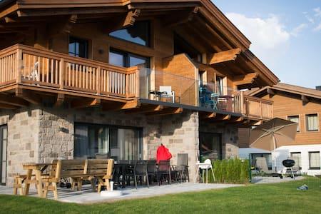 Bergbiberhaus A: gelijkvloers met terras & sauna - Piesendorf
