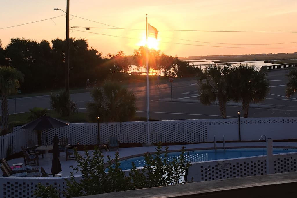Sunrise over the beautiful Intracoastal. Bridge to the right brings you into Wrightsville Beach. This shot was taken from our front door!