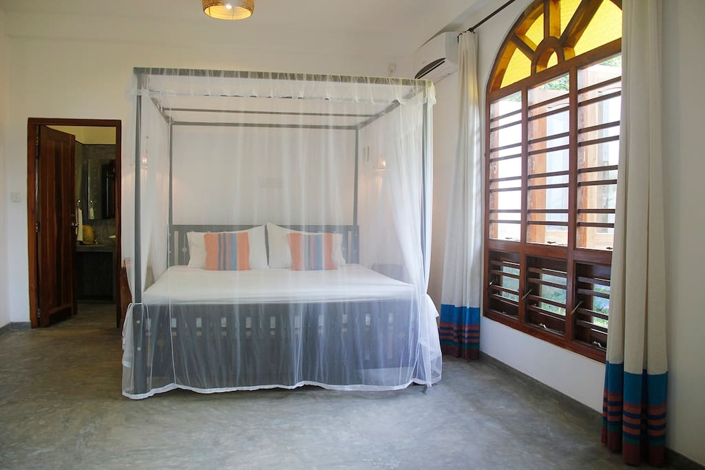 The large, cool bedroom with en-suite private bathroom.
