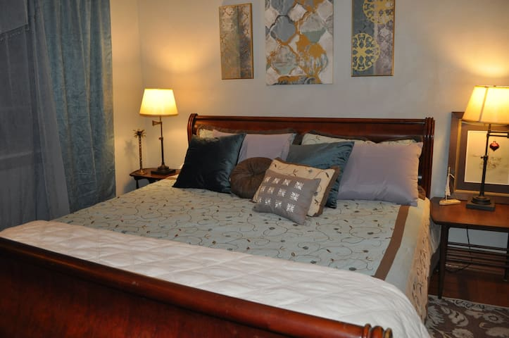 King size bed, lots of pillows and a new, comfortable mattress.