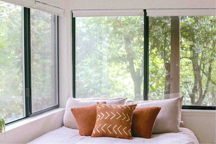 Wake up each morning in a queen bed, under soft sheets, surrounded by trees.