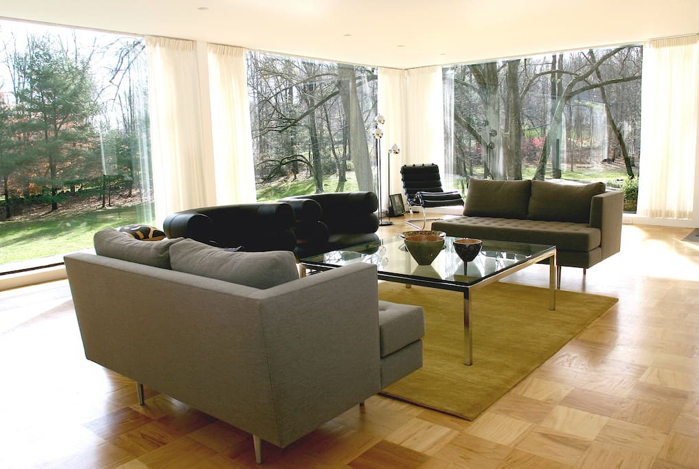 Huge living room with floor-to-ceiling windows on 3 sides.