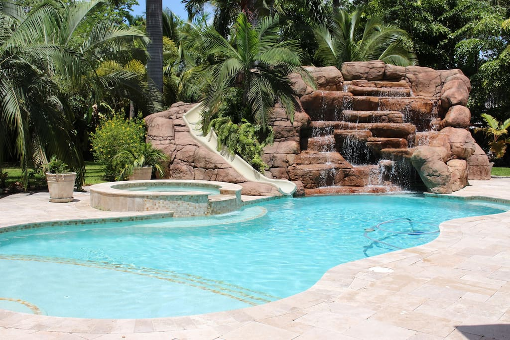 15 foot waterfall with swim-through grotto & water slide.