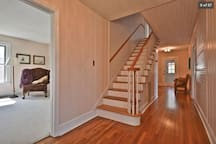 Stairs leading to 3 additional bedrooms and a full bath. Wide hallways offer a spacious feeling.