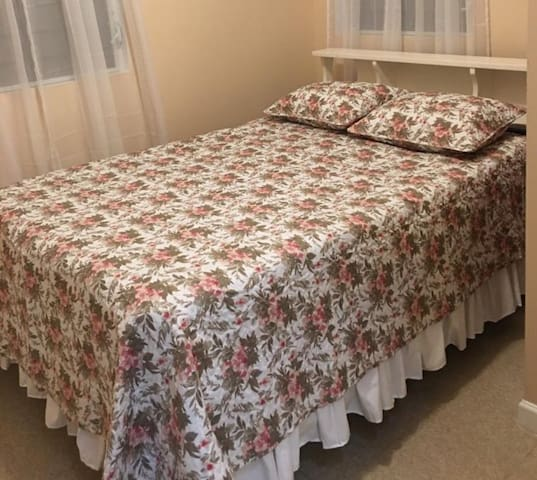Queen size bed. Room has air conditioner and ceiling fan.