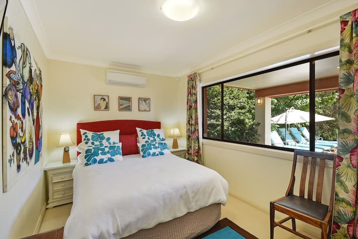 Main bedroom has a queen bed and overlooks the private garden. Air conditioning and TV