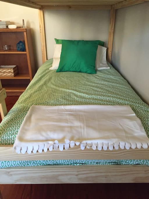 Bottom bunk. There's an extra blanket in case you get cold and I have a couple sets of sheets.
