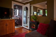 Toward bathroom and electric fireplace (cozy).