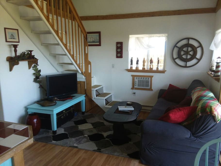 Relax in cabin one's comfortable and surprisingly spacious living room.