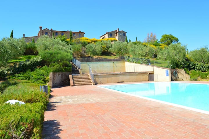 Apartment with 2 pools in the medieval village of Asciano, in the hills of Siena