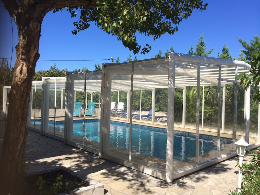 Pool with conservatory cover