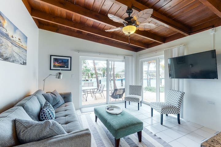 New listing! Beachy getaway w/ shared pool, water views, & furnished patio!