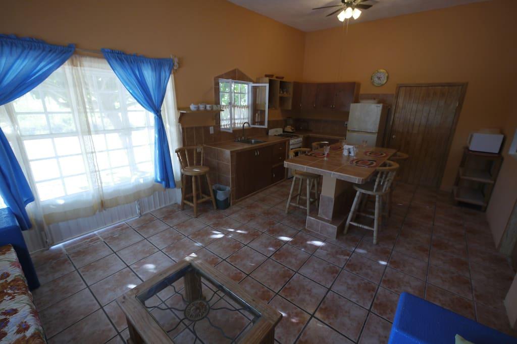 Living Area and Kitchen  Sala de estar y cocina
