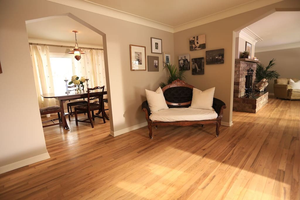 ENTRY WAY: Refinished oak hardwood floors throughout the main level. Huge windows everywhere make it bright and warm and give you great views of the property