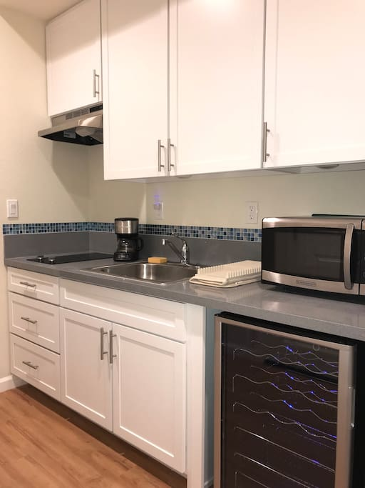 Your own kitchenette with stove, microwave, mini fridge & coffee maker!