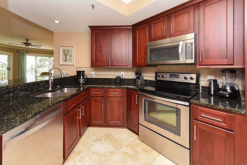 Kitchen has high end cabinetry and great storage