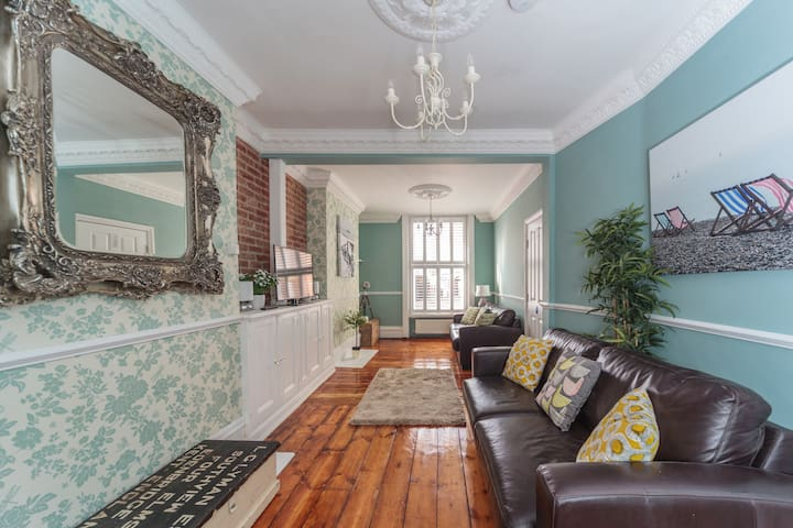 We love the look of this beautifully restored regency living room with it's sanded wooden floor, and plantation shutters.