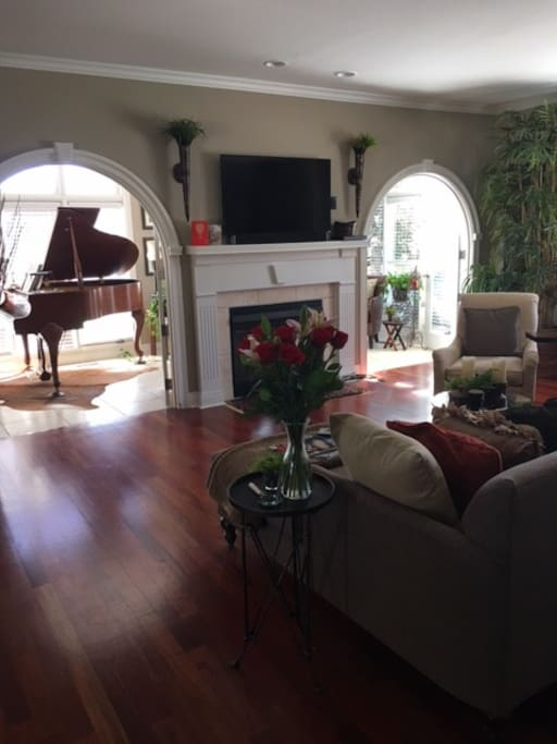 Gorgeous living room and sunroom. Grant piano to play