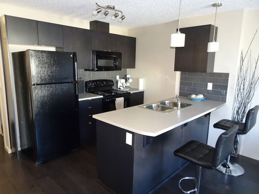 Open concept kitchen with eatery bar.