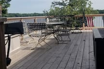 Side of wrap-around deck.  Dining area