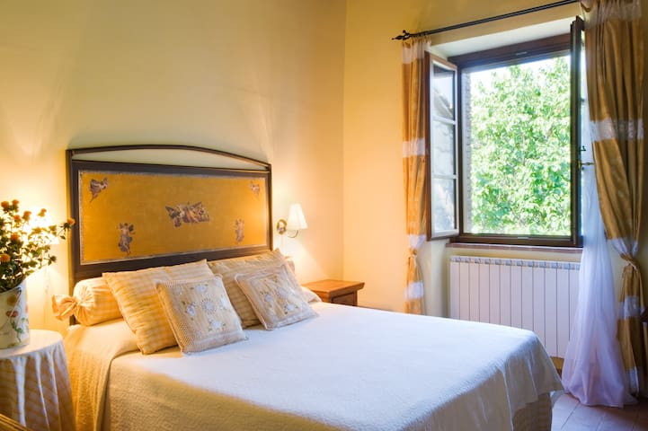 Bedroom 4 - One of the three bedrooms on the main villa's first floor with a queen size bed and en suite bathroom.