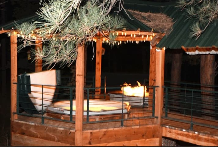 Private Hot tub with fire table in a custom built Gazebo