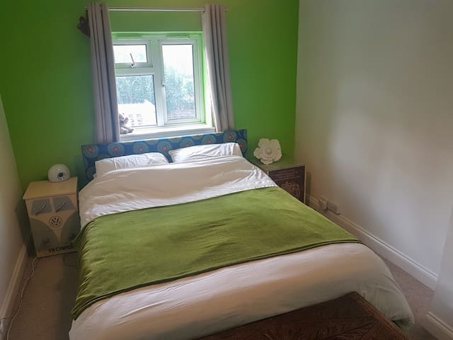 lovely bright bedroom with comfy king sized bed
