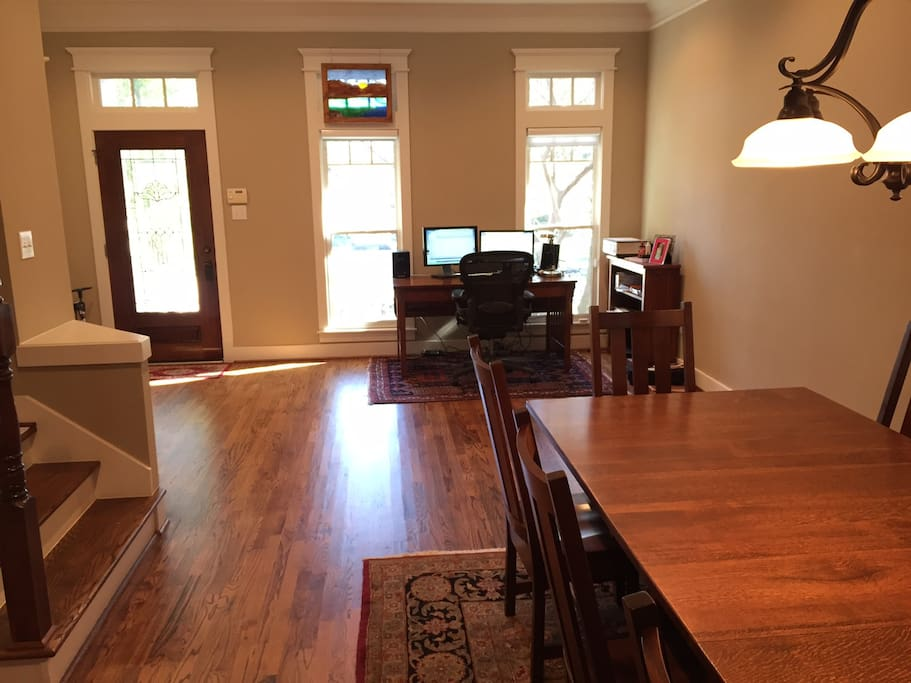 Front door, Dining and front room. Oak desk for guest use.