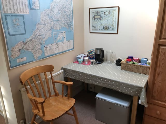 Tea and coffee area (with fridge) outside your room