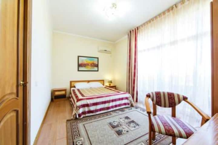 Комната в уютном мини-отеле