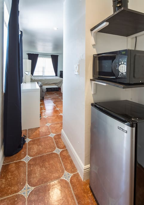 Mini fridge with small freezer, microwave and coffee maker come with the room.