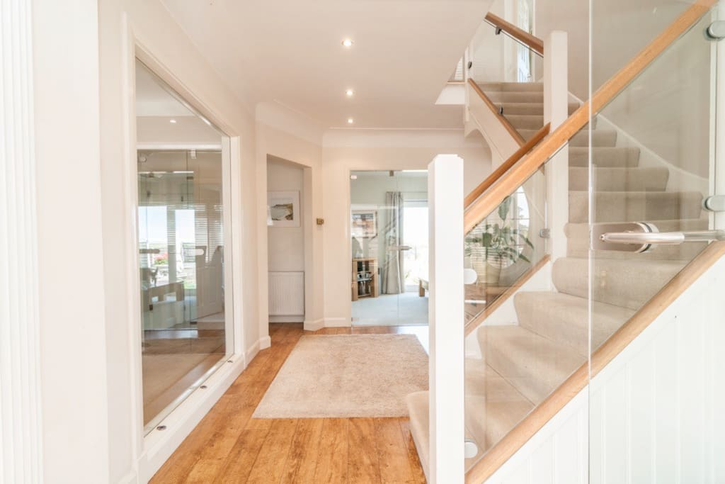 A light and airy entrance hall with glass doors.