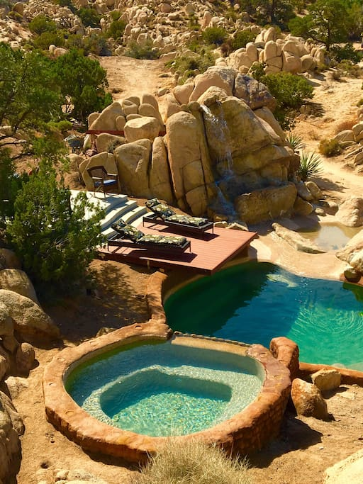 The Emerald Lagoon pool and jacuzzi is situated between the main house (Casa de Encanto) and the Cottage.