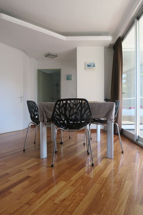 Comfortable chairs and dining table that seats four people easily.