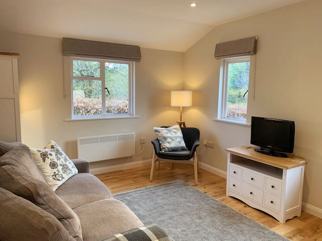 The comfortable, light living area has a smart TV with both free to air television and streamed content