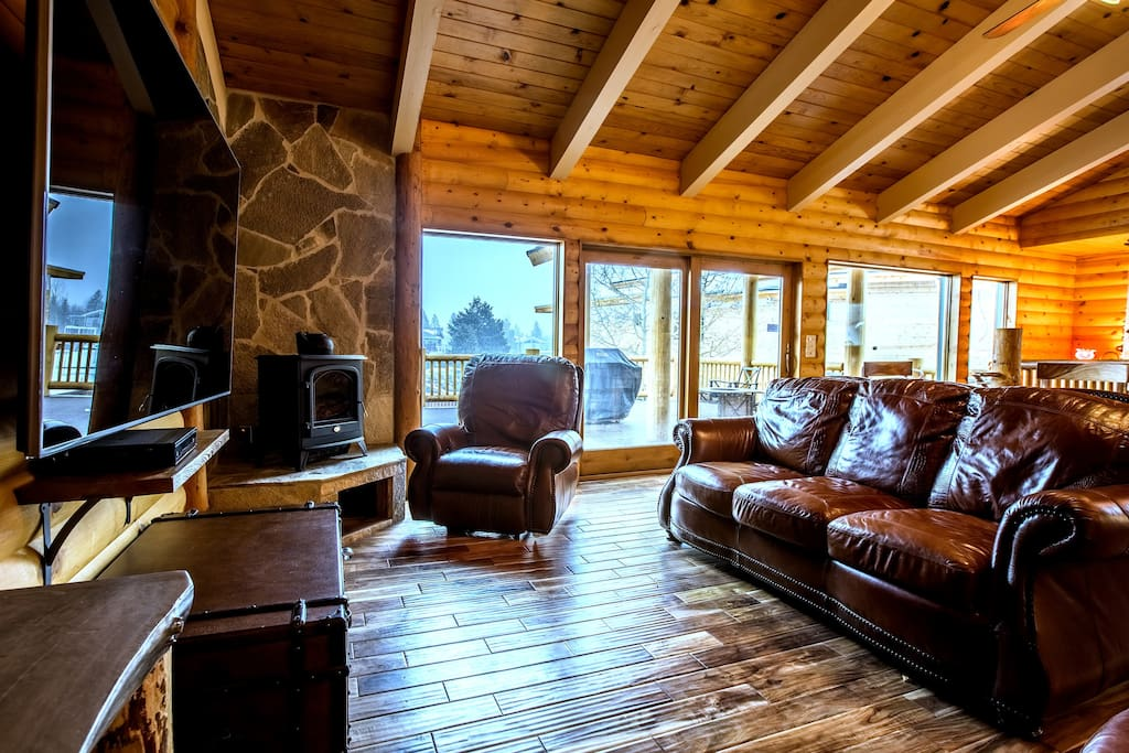 "The great room: now with brand new 51"" large HDTV with cable box and Blu-ray, fireplace, opens to the expansive deck outside"