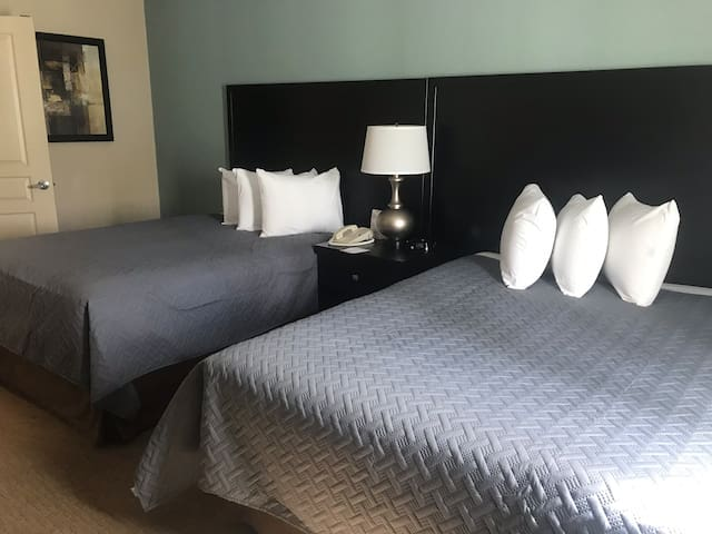 Bedroom with two quee size beds, tv .