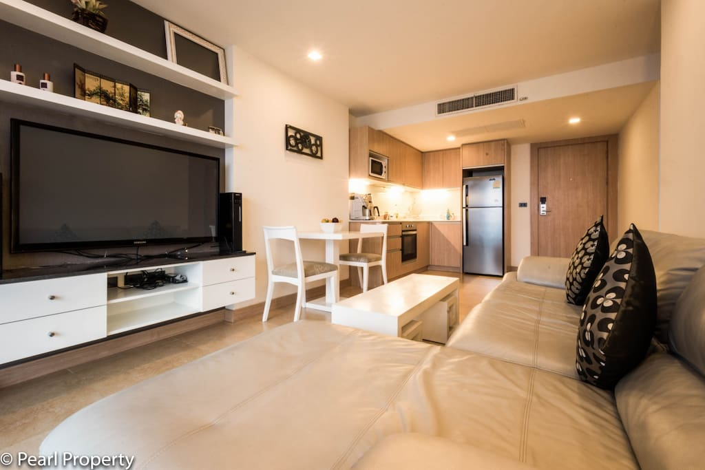 A big 3D TV with a Home Entertainment System is part of the apartment.