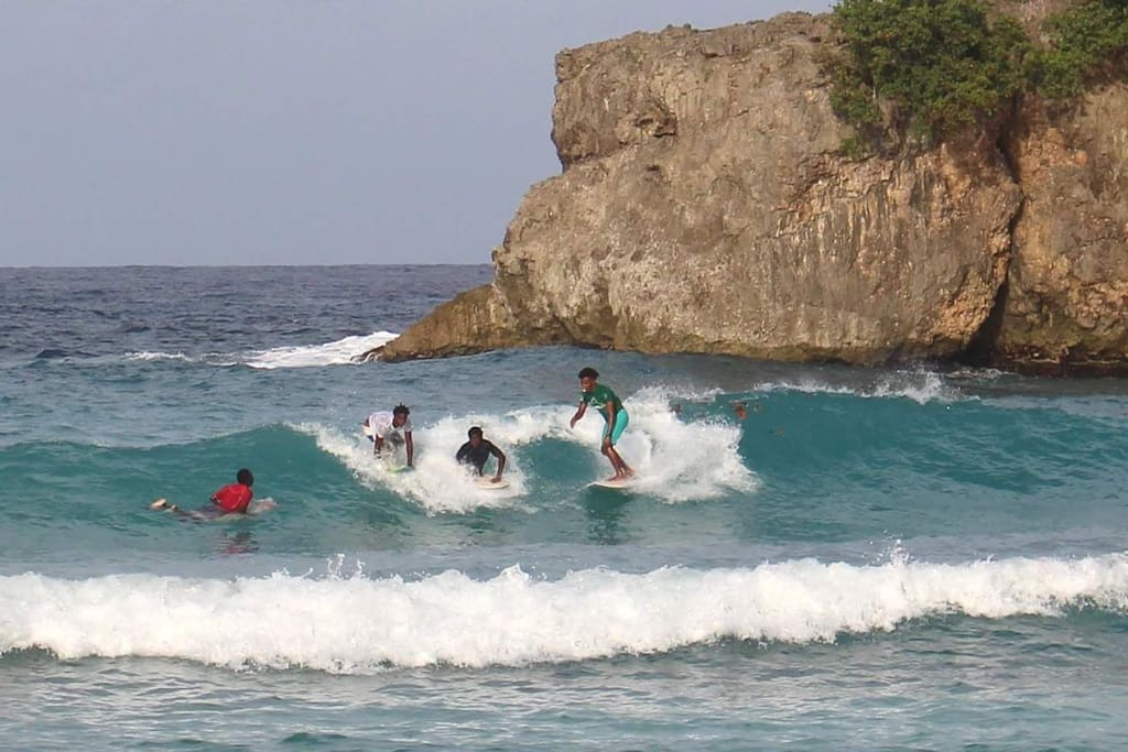 Locals having fun riding the waves