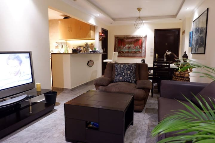 Aesthetic Madinaty apartment with a Garden