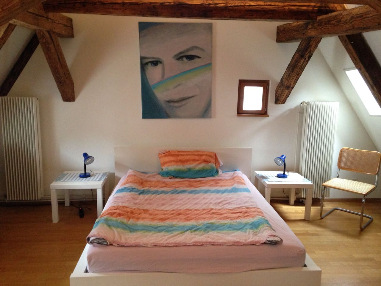 bedroom with painting, the whole apartment is full of original paintings by an artist friend, they are for sale as well