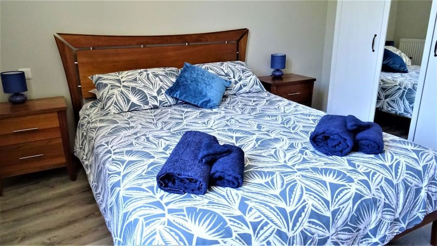 King bed with luxe mattress topper and wardrobes