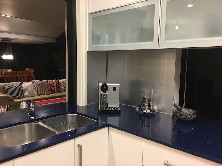 Modern kitchen with complimentary coffee, tea, continental breakfast.