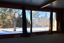 Large Bay windows showcase the beautiful surrounding area.