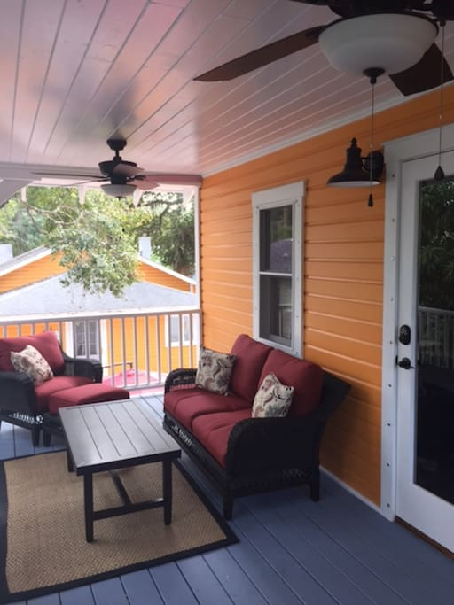 Outdoor porch captures Florida breezes while guests relax in the shade