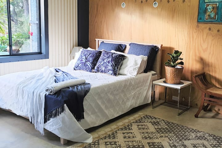 Look out onto the garden and native bush from your bedroom. The bed provided for you is King-sized and comfortable with new luxurious linen.